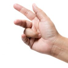 Image shows ring finger stuck in palm due to trigger finger.