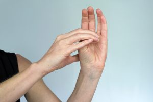 Passive Thumb flexion and extension exercise