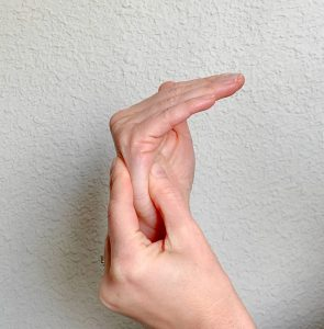 Image of active MP flexion also known as knuckle benders